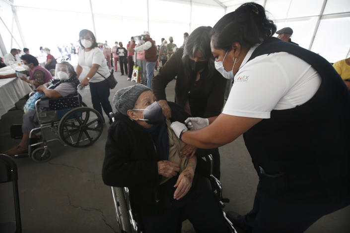 An elderly woman gets her Sinovac Biotech COVID-19 vaccine at the Americas sports center in Ecatepec, a borough on the outskirts of Mexico City, Tuesday, Feb. 23, 2021. (Foto AP/Marco Ugarte