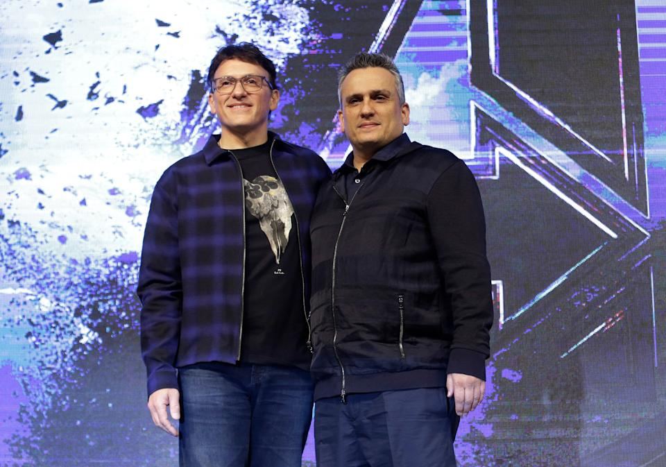 """Director Anthony Russo, left, and Joe Russo pose during an Asia Press Conference to promote their latest film """"Avengers Endgame"""" in Seoul, South Korea, Monday, April 15, 2019. The movie will open on April 24 in South Korea. (AP Photo/Ahn Young-joon)"""