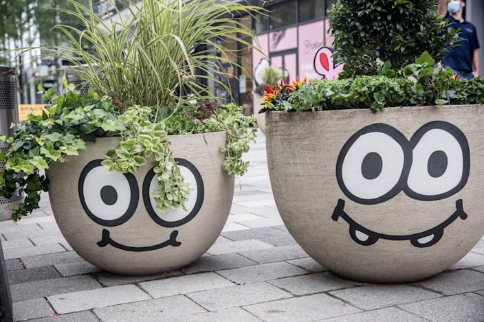 Even the planters near Burgerman's work have been decked out with smiles and googly eyes of their own.