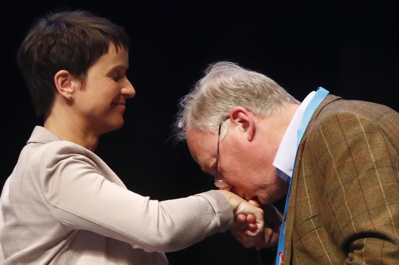 Alexander Gauland of Germany's anti-immigration party Alternative for Germany (AFD) kisses the hand of party chairwoman Frauke Petry during an AFD party congress in Cologne Germany, April 23, 2017. REUTERS/Wolfgang Rattay .      TPX IMAGES OF THE DAY
