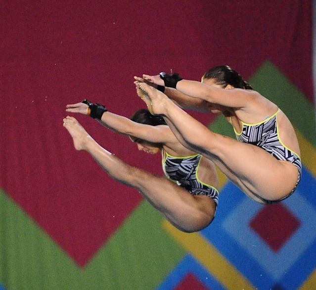 Canadian Roseline Filion (L) and Meaghan Benfeito make their routine in the women´s 10m synchronised platform competition during the XVI Pan American Games Guadalajara 2011 in Guadalajara, Mexico, on October 27, 2011. AFP PHOTO / RODRIGO BUENDIA (Photo credit should read RODRIGO BUENDIA/AFP/Getty Images)
