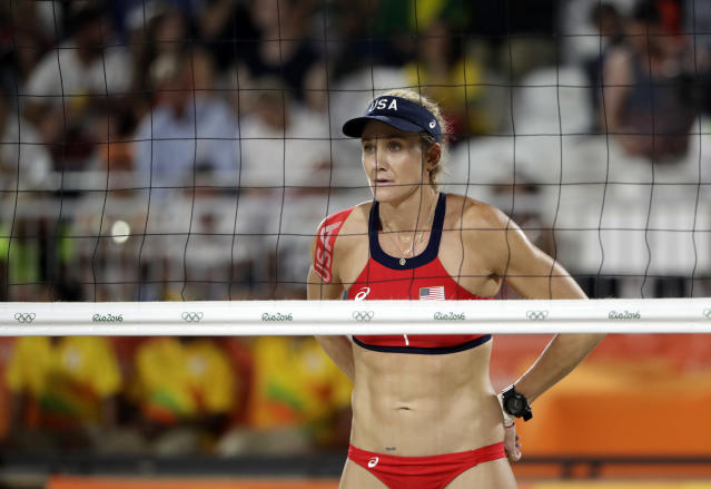 "FILE - In this Aug. 15, 2016, file photo, United States' Kerri Walsh Jennings awaits a serve against Australia during a women's beach volleyball quarterfinal match at the 2016 Summer Olympics in Rio de Janeiro, Brazil. The five-time Olympian Kerri has not yet committed to play in AVP events this summer, leading the domestic beach volleyball tour to announce its 2017 schedule without including the game's top draw among ""the most respected names in the sport"" who are expected to participate. (AP Photo/Marcio Jose Sanchez, File)"