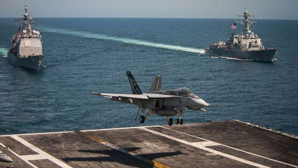 PHOTO: An F/A-18E Super Hornet lands on the flight deck of the USS Carl Vinson and the USS Lake Champlain (CG 57) (L) and the Arleigh Burke-class guided-missile destroyer USS Wayne E. Meyer (DDG 108), May 3, 2017, in the western Pacific Ocean. (Sean M. Castellano/U.S. Navy via Getty Images)