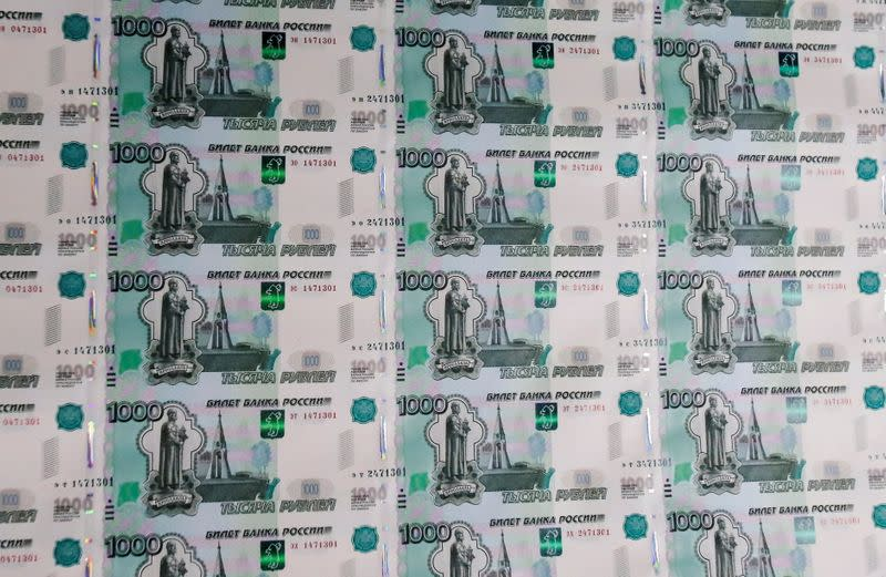 FILE PHOTO: A sheet of 1000 Russian Rouble notes at Goznak printing factory in Moscow