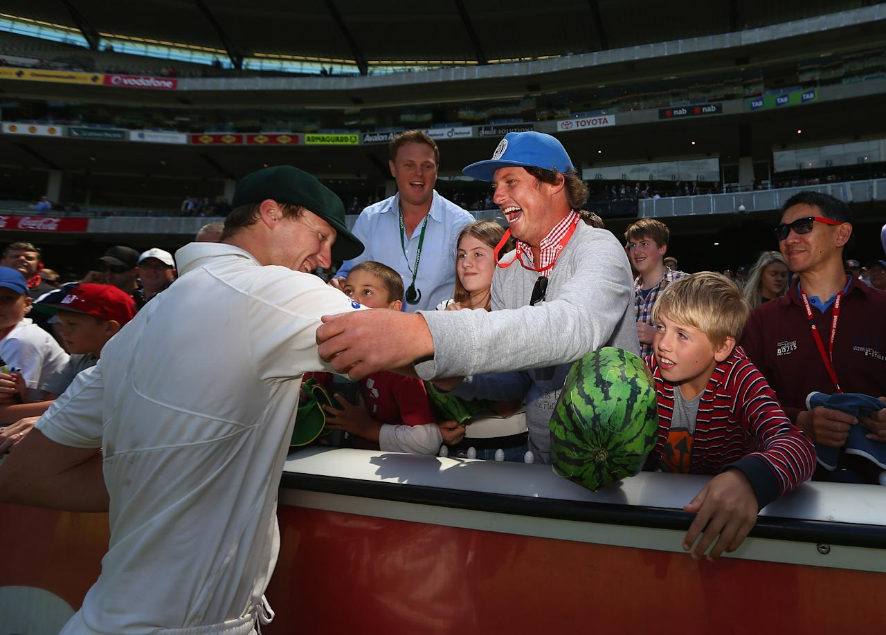 MELBOURNE, AUSTRALIA - DECEMBER 28:  Jackson Bird of Australia celebrates with fans after Australia defeated Sri Lanka on day three of the Second Test match between Australia and Sri Lanka at Melbourne Cricket Ground on December 28, 2012 in Melbourne, Australia.  (Photo by Robert Cianflone/Getty Images)