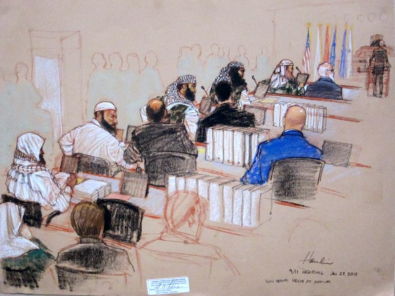 In this pool photo of a sketch by courtroom artist Janet Hamlin and reviewed by the U.S. Department of Defense, the five Sept. 11 defendants, back row from left, Mustafa Ahmad al-Hawsawi, Ammar al Baluchi, Ramzi Binalshibh, Walid bin Attash and the self-proclaimed terrorist mastermind Khalid Sheikh Mohammed, attend a hearing on pretrial motions in their death penalty case at the Guantanamo Bay U.S. Naval Base in Cuba, Monday, Jan. 28, 2013. Two of the defendants delayed the start of the hearing Monday when they refused to respond to questions from military judge U.S. Army Col. James Pohl, top right. (AP Photo/Janet Hamlin, Pool)