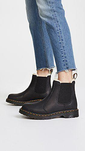 """<p><strong>Dr. Martens</strong></p><p>amazon.com</p><p><strong>$159.99</strong></p><p><a href=""""https://www.amazon.com/dp/B01B271IK0?tag=syn-yahoo-20&ascsubtag=%5Bartid%7C2164.g.37678622%5Bsrc%7Cyahoo-us"""" rel=""""nofollow noopener"""" target=""""_blank"""" data-ylk=""""slk:Shop Now"""" class=""""link rapid-noclick-resp"""">Shop Now</a></p><p>You won't ever have to worry about cold feet in these boots. They're lined with a warm faux fur for ultimate comfort! </p>"""