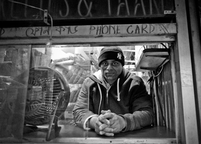<p>Store owner Mohamed Islam at the store he's had since 2001, near Roosevelt Ave subway stop in Jackson Heights, Queens, N.Y., in December 2015. He emigrated from Bangladesh in 1987. (Photo: Yunghi Kim/Contact Press Images) </p>