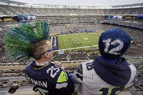 Seattle Seahawks fans John Hanshaw, left, and Pete Ford, both of Tacoma, Wash., watch the field before the NFL Super Bowl XLVIII football game between the Seattle Seahawks and the Denver Broncos, Sunday, Feb. 2, 2014, in East Rutherford, N.J. (AP Photo/Mel Evans)
