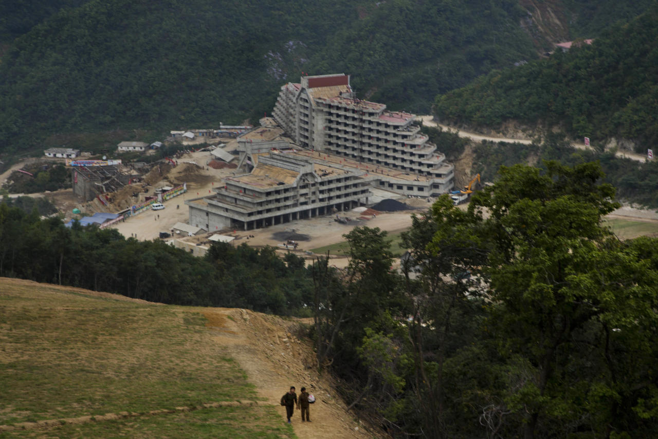 "In this Friday Sept. 20, 2013 photo, an unfinished hotel complex stands at the bottom of a mountain slope at the ski resort construction project at North Korea's Masik Pass. This is the Masik Pass ski resort, North Korea's latest megaproject, the product of 10 months of furious labor intended to show the world that this country, so often derided for its poverty and isolation, is as civilized and culturally advanced as any other. North Korean authorities have been encouraging a broader interest in sports in the country, calling it ""the hot wind of sports blowing through Korea."" (AP Photo/David Guttenfelder)"