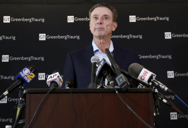 Former Louisville basketball coach Rick Pitino talks to reporters during a news conference in New York, Wednesday, Feb. 21, 2018. Pitino held the news conference in the wake of an NCAA decision in a sex scandal case that strips the Cardinals program of 123 victories, a national championship and $600,000 in postseason revenue. (AP Photo/Seth Wenig)