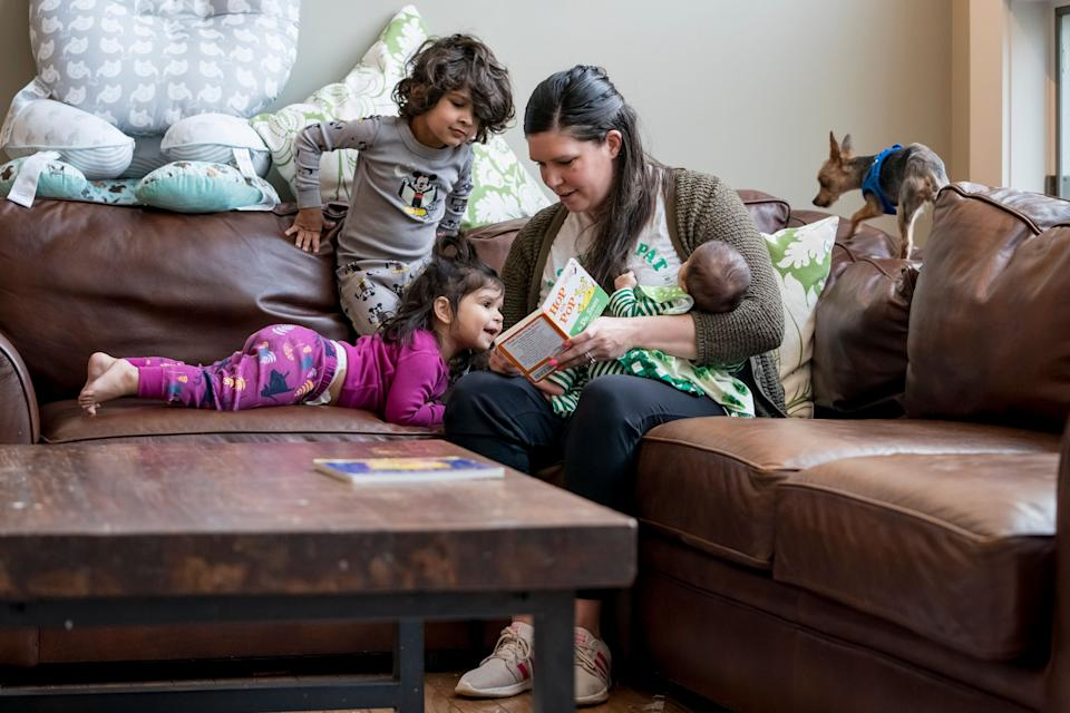 In Missouri, Katie Patel is shortening her maternity leave to go back to work as an urgent care nurse to fill in for a quarantined co-worker. Her husband, Neal Patel, is an ER physician who has been taking extra precautions after his shift to protect his family from the virus. (Photo: Whitney Curtis for The Washington Post via Getty Images)