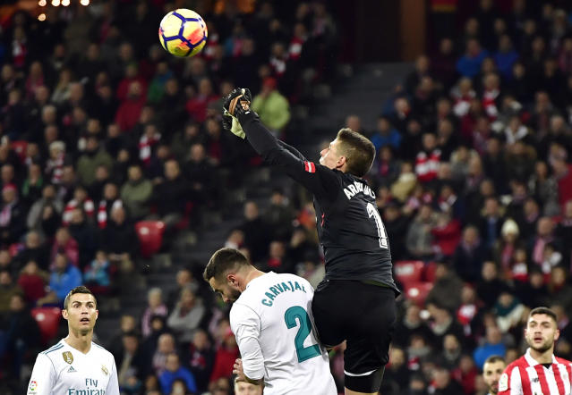 "FILE - In this Saturday, Dec. 2, 2017 file photo, Athletic Bilbao's goalkeeper Kepa Arrizabalaga, top, pushes the ball beside Real Madrid's Daniel Carvajal during their Spanish La Liga soccer match at San Mames stadium, in Bilbao, northern Spain. Athletic Bilbao has said on Monday, Jan. 22, 2018 it has extended the contract of young goalkeeper Kepa Arrizabalaga until June 2025, ending speculation about his move to Real Madrid. The 23-year-old Kepa admitted he had offers to leave Athletic, but decided to stay at the club he considers his ""home."" (AP Photo/Alvaro Barrientos, file)"