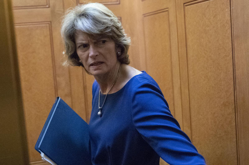 "Sen. Lisa Murkowski, R-Alaska, turns to answer a reporter's question after the Democratic policy luncheon on Capitol Hill, Wednesday, Oct. 10, 2018 in Washington. Murkowski is brushing back against President Donald Trump, saying she knows her state's political terrain ""better than he does."" Trump says voters ""will never forgive"" Murkowski for opposing Brett Kavanaugh's nomination to the Supreme Court, and he says the senator will ""never recover"" politically. (AP Photo/Alex Brandon)"