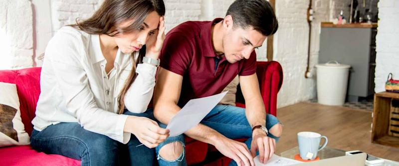 young married couple with finance problems and emotional stress