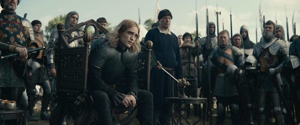 A photo of Robert Pattinson in a scene from The King.
