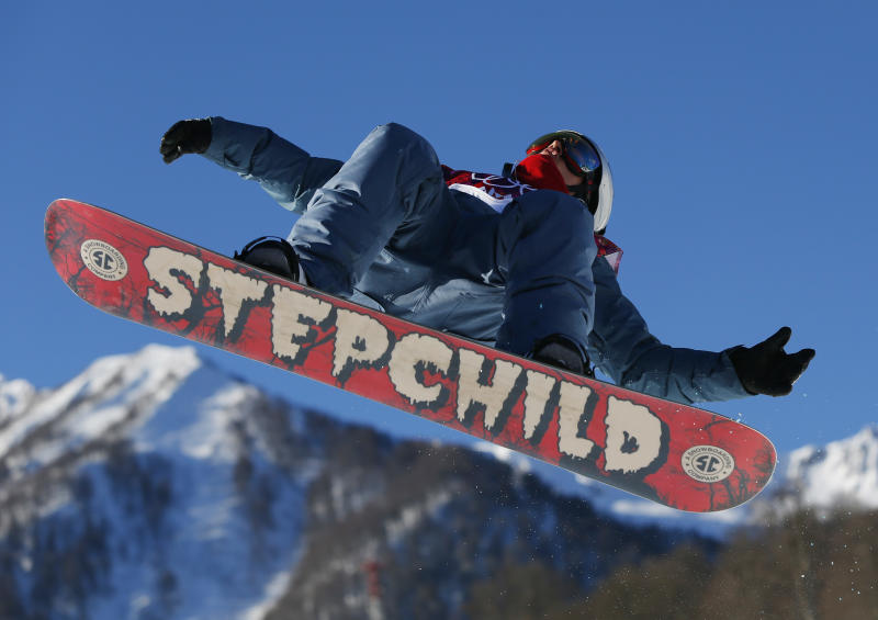 Russia's Alexey Sobolev takes a jump during men's snowboard slopestyle qualifying at the Rosa Khutor Extreme Park ahead of the 2014 Winter Olympics, Thursday, Feb. 6, 2014, in Krasnaya Polyana, Russia. (AP Photo/Sergei Grits)