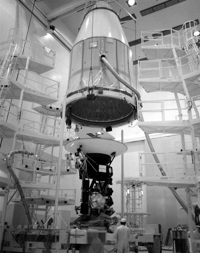 The Voyagers 2 spacecraft, as it was being encapsulated into the shroud that will protect it from during its flight to space. Image credit: NASA/JPL