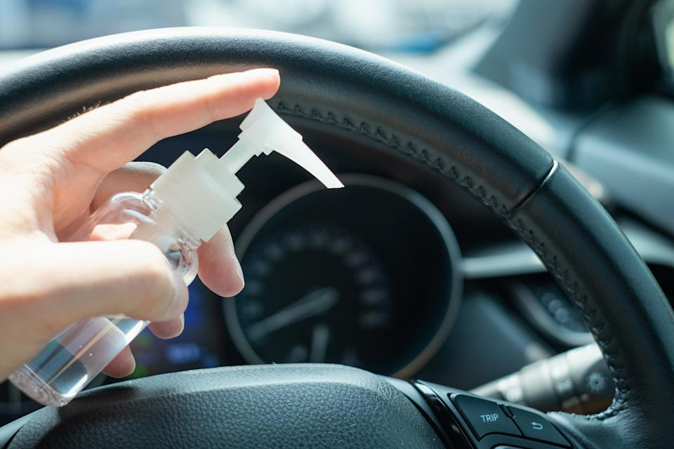 Now that the weather is warming up, many are wondering whether it's safe to keep hand sanitizer in your car. Experts say yes, but with some caveats. (Photo: Getty Images)