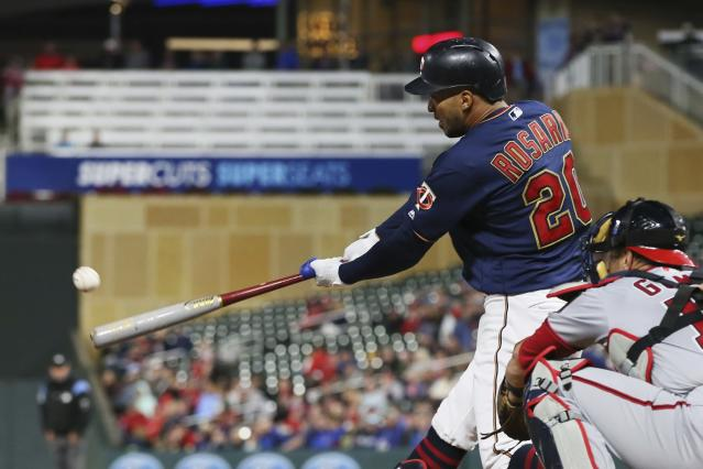 Minnesota Twins' Eddie Rosario hits an RBI-single off Washington Nationals' starting pitcher Patrick Corbin in the first inning of a baseball game Thursday, Sept. 12, 2019, in Minneapolis. (AP Photo/Jim Mone)