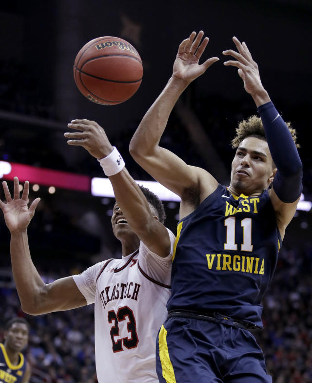 West Virginia's Emmitt Matthews Jr. (11) and Texas Tech's Jarrett Culver vie for a rebound during the second half of an NCAA college basketball game in the Big 12 men's tournament Thursday, March 14, 2019, in Kansas City, Mo. West Virginia won 79-74. (AP Photo/Charlie Riedel)