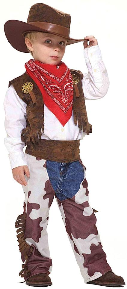"""<p>Shop a new <a href=""""https://www.popsugar.com/buy/Cowboy-Kid-Costume-507392?p_name=Cowboy%20Kid%20Costume&retailer=amazon.com&pid=507392&price=12&evar1=moms%3Aus&evar9=32267581&evar98=https%3A%2F%2Fwww.popsugar.com%2Ffamily%2Fphoto-gallery%2F32267581%2Fimage%2F32267606%2FCowboy&list1=amazon%2Challoween%2Cfall%2Conesies%2Challoween%20costumes%2Ckid%20shopping%2Challoween%20for%20kids%2Ckid%20halloween%20costumes&prop13=api&pdata=1"""" rel=""""nofollow"""" data-shoppable-link=""""1"""" target=""""_blank"""" class=""""ga-track"""" data-ga-category=""""Related"""" data-ga-label=""""https://www.amazon.com/Forum-Novelties-Cowboy-Costume-Small/dp/B003A8IQHI/ref=sr_1_3?keywords=kids+cowboy+costume&amp;qid=1572037917&amp;sr=8-3"""" data-ga-action=""""In-Line Links"""">Cowboy Kid Costume</a> ($12) or look for similar pieces at thrift stores to make your little one rodeo-ready on <a class=""""sugar-inline-link ga-track"""" title=""""Latest photos and news for Halloween"""" href=""""https://www.popsugar.com/Halloween"""" target=""""_blank"""" data-ga-category=""""Related"""" data-ga-label=""""https://www.popsugar.com/Halloween"""" data-ga-action=""""&lt;-related-&gt; Links"""">Halloween</a>.</p>"""