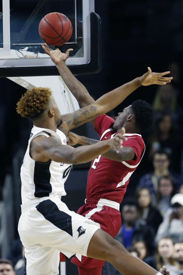 Arkansas' Adrio Bailey (2) shoots against Providence's Nate Watson during the first half of a first round NCAA National Invitation Tournament college basketball game in Providence, R.I., Tuesday, March 19, 2019. (AP Photo/Michael Dwyer)