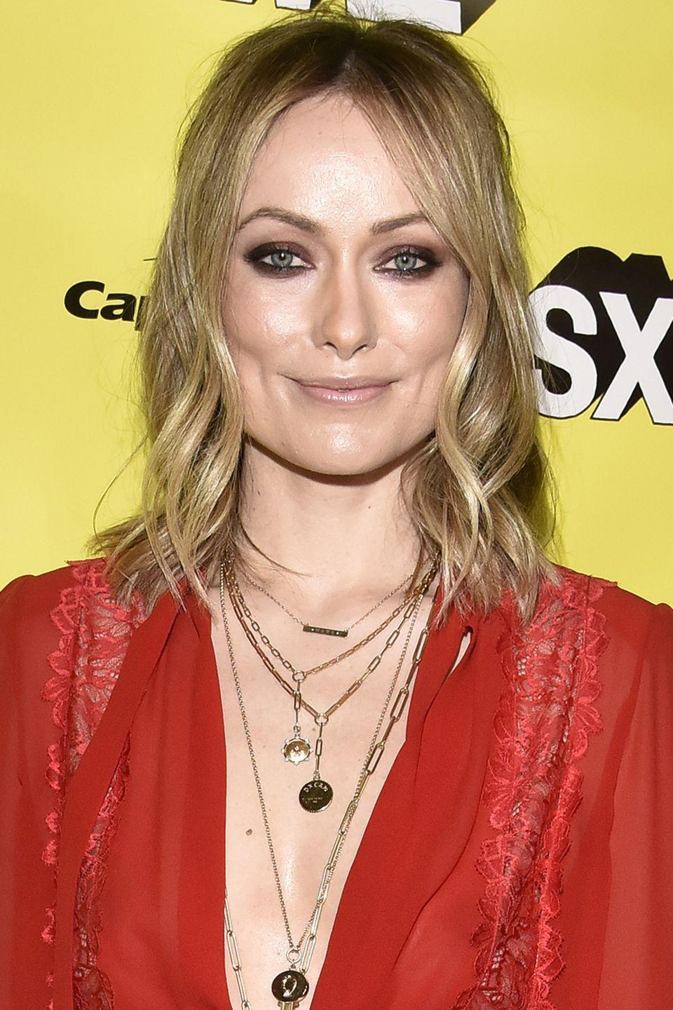 <p>A half up half down style doesn't have to look so structured. Wear it more casual by gathering hair loosely at the back like Olivia Wilde. </p>