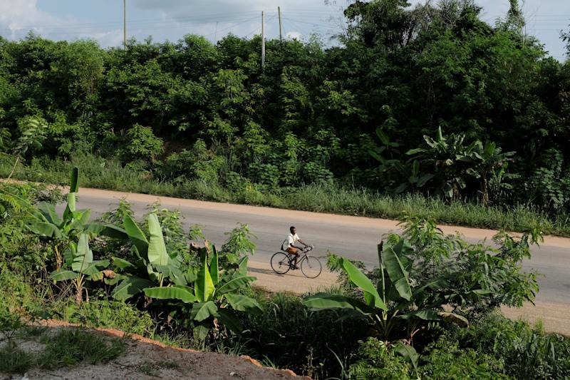 A boy rides along a road in Denyase, Ashanti region, Ghana. (Photo: Francis Kokoroko/Reuters)