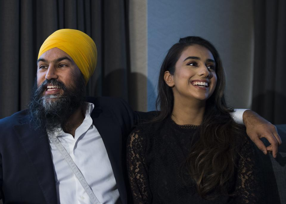 NDP Leader Jagmeet Singh and his wife Gurkiran Kaur watch the Canadian election results come in at his hotel room in Burnaby, B.C., on Monday, October 21, 2019. THE CANADIAN PRESS/Nathan Denette