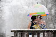 """<p>A snowy wedding day on March 16, 2013 made for some truly beautiful photos. """"There has been no greater happiness than having the people we love celebrate the love we found and committed to. Our wedding day surrounded us with the joy, beauty and support that had gotten us to that day, and has kept us celebrating since,"""" Kim and Tara told us.</p>"""