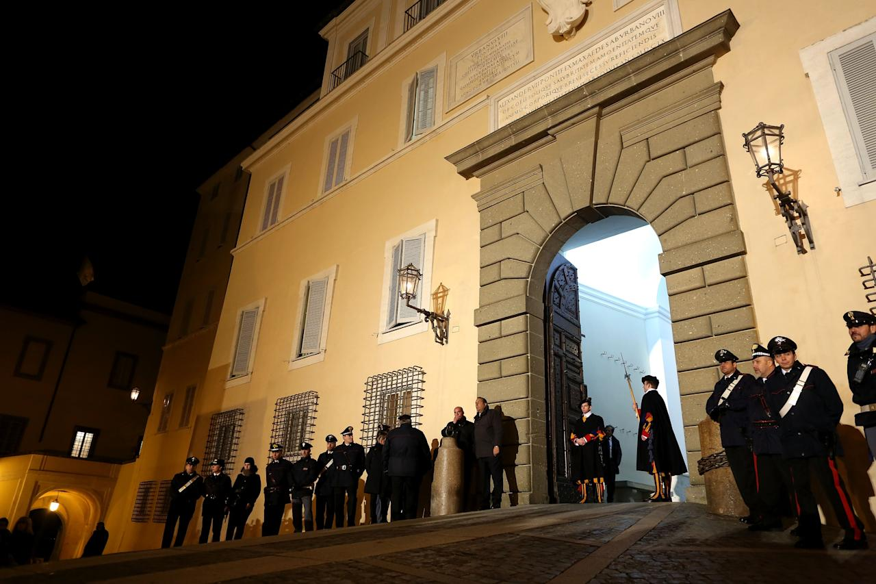 ROME, ITALY - FEBRUARY 28:  Swiss Guards prepare to close the gate of the Apostolic Palace closes after Pope Benedict XVI greeted the pilgrims, for the last time as head of the Catholic Church, from the window of Castel Gandolfo where he will start his retirement today on February 28, 2013 in Rome, Italy. Pope Benedict XVI has been the leader of the Catholic Church for eight years and is the first Pope to retire since 1415. He will stay at the Papal Summer residence of Castel Gandolfo until renovations are complete at a monastery in the grounds of the Vatican and will be known as Roman pontiff emeritus or pope emeritus on February 28, 2013 in Rome, Italy.  (Photo by Franco Origlia/Getty Images)