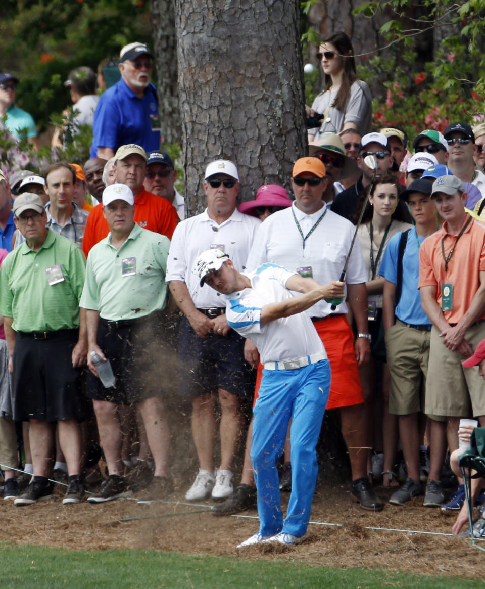 Jonas Blixt, of Sweden, hits out of the rough off the second fairway during the fourth round of the Masters golf tournament Sunday, April 13, 2014, in Augusta, Ga. (AP Photo/Matt Slocum)