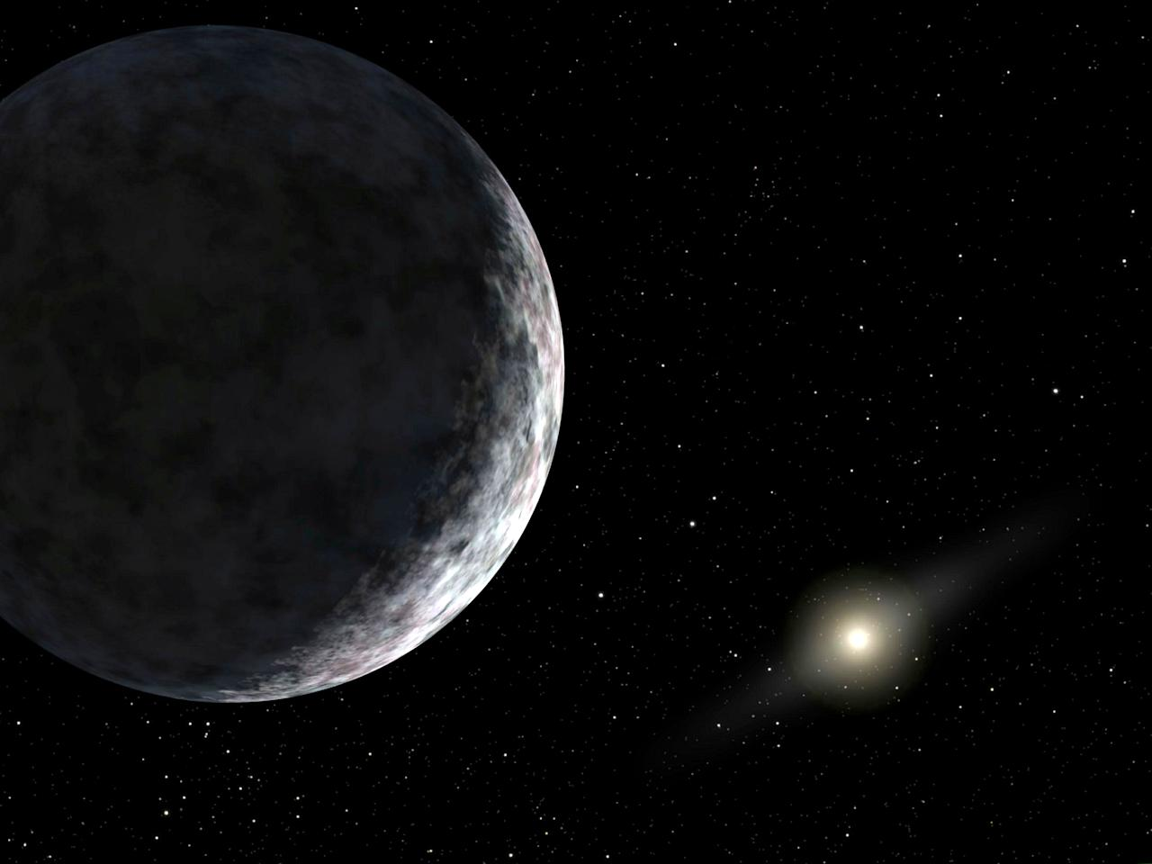 A California astronomer has discovered what he believes is the 10th planet in our solar system, a group of NASA-funded researchers said on July 29, 2005. The new planet, known as 2003UB313, has been identified as the most distant object ever detected orbiting the sun, California Institute of Technology astronomer Michael Brown said. This artist's concept shows planet 2003UB313 at the lonely outer fringes of our solar system. Our sun can be seen in the distance. The new planet, which is yet to be formally named, is at least as big as Pluto and about three times farther away from the Sun than Pluto. The planet was discovered by the Samuel Oschin Telescope at the Palomar Observatory near San Diego, Calif., on January 8, 2005. (CREDIT : REUTERS/NASA/JPL-Caltech/HO)