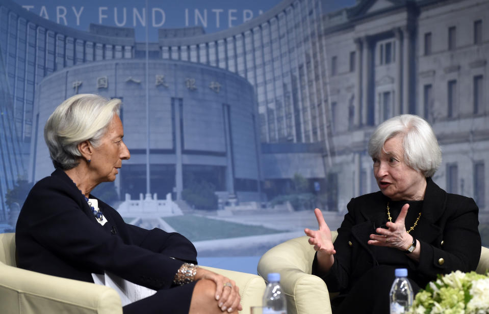FILE - In this July 2, 2014, file photo International Monetary Fund Managing (IMF) Director Christine Lagarde, left, and Federal Reserve Chair Janet Yellen sit down for a conversation at the IMF in Washington. (AP Photo/Susan Walsh, File)
