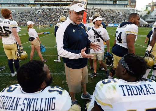 Georgia Tech first-year defensive coordinator Nate Woody speaks to players during the NCAA college football team's intrasquad scrimmage Friday, April 20, 2018, in Atlanta. (AP Photo/Mike Stewart)