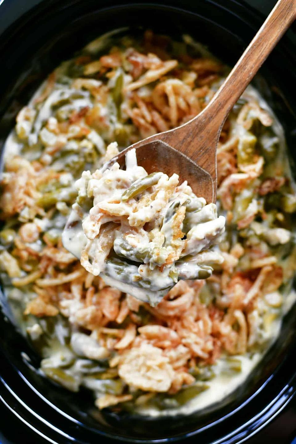 """<p>The slow cooker is a life-saver for any holiday meal.</p> <p><b>Get the recipe:</b> <a href=""""https://www.thegunnysack.com/slow-cooker-green-bean-casserole/"""" class=""""link rapid-noclick-resp"""" rel=""""nofollow noopener"""" target=""""_blank"""" data-ylk=""""slk:slow-cooker green bean casserole"""">slow-cooker green bean casserole</a></p>"""
