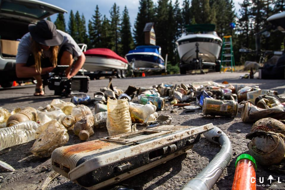 This photo provided by Clean Up The Lake shows a pile of trash taken from the bottom of Lake Tahoe by a group of scuba divers during a cleanup on Friday, May 14, 2021. The dive team of professionals and volunteers spearheaded by Clean Up The Lake, began an extraordinary effort to recover trash that has been accumulating untouched under the surface of the lake for decades. (Clean Up The Lake via AP)