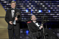 FILE - In this July 17, 2013, file photo, Dick Hoyt, left, and Rick Hoyt, accept the Jimmy V Perseverance Award at the ESPY Awards at the Nokia Theater in Los Angeles. Dick Hoyt, who last competed with his son in the Boston Marathon in 2014, has died, the Boston Athletic Association announced Wednesday, March 17, 2021. He was 80. (Photo by John Shearer/Invision/AP, File)