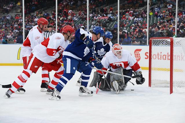 DETROIT, MI - DECEMBER 31: Goaltender Ken Holland #35 of the Detroit Red Wings makes the save on a shot from Brad May #10 of the Toronto Maple Leafs in the first period during the 2013 Hockeytown Winter Festival Alumni Showdown on December 31, 2013 at Comerica Park in Detroit, Michigan. (Photo by Jamie Sabau/Getty Images)