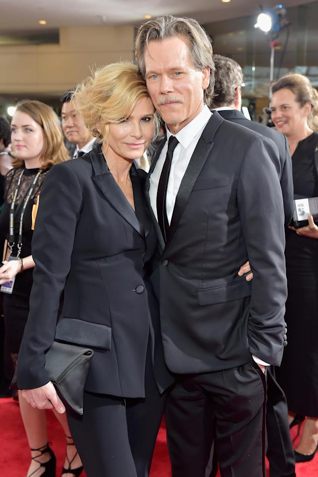 Kyra Sedgwick and Kevin Bacon were attached at the hip all night at the Golden Globes. (Photo: Stefanie Keenan/Getty Images for Fiji Water)