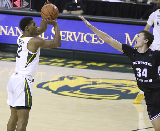 Baylor guard Jared Butler (12) attempts a three point shot over Central Arkansas guard Jaxson Baker (34) in the first half of an NCAA college basketball game, Tuesday, Dec. 29, 2020, in Waco, Texas. (AP Photo/ Jerry Larson)