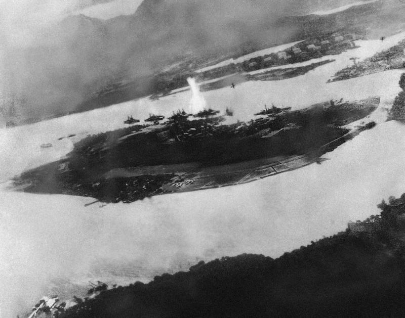 Believed to be the first bomb dropped on Pearl Harbor, Hawaii in the sneak-attack on Dec. 7, 1941, this picture was found torn to pieces at Yokusuka Base by photographer's mate 2/C Martin J. Shemanski of Plymouth, Pa. One Japanese plane is shown pulling out of a dive near bomb eruption (center) and another the air at upper right.