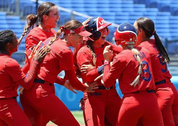 PHOTO: The United States softball team celebrates after winning their fourth game on July, 25, 2021 in Yokohama, Japan. (Jorge Silva/Reuters)
