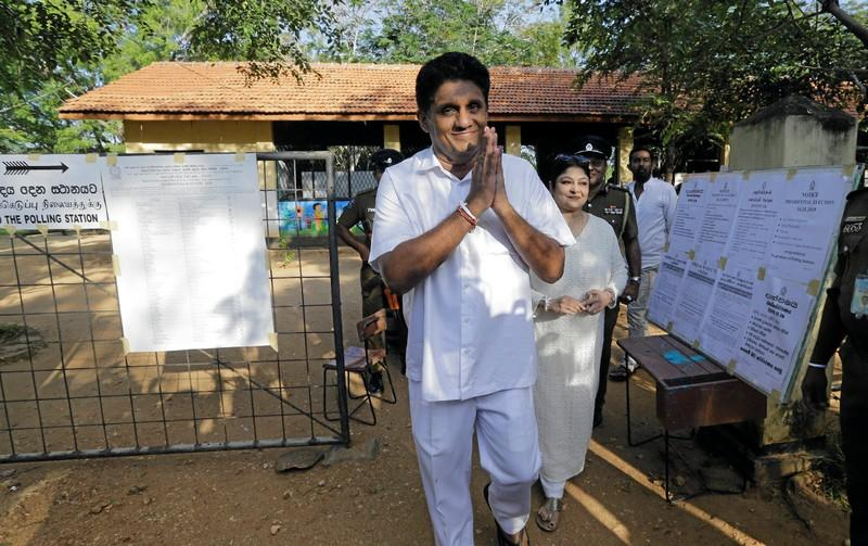 Premadasa, Sri Lanka's presidential candidate of the ruling United National Party led New Democratic Front alliance gesture as he leaves after casting his vote during the presidential election in Weerawila