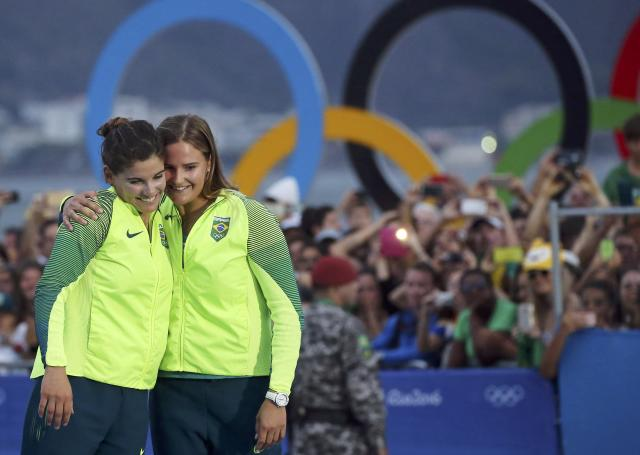 2016 Rio Olympics - Sailing - Victory Ceremony - Women's Skiff - 49er FX - Victory Ceremony - Marina de Gloria - Rio de Janeiro, Brazil - 18/08/2016. Martine Grael (BRA) of Brazil and Kahena Kunze (BRA) of Brazil celebrate. REUTERS/Benoit Tessier FOR EDITORIAL USE ONLY. NOT FOR SALE FOR MARKETING OR ADVERTISING CAMPAIGNS.