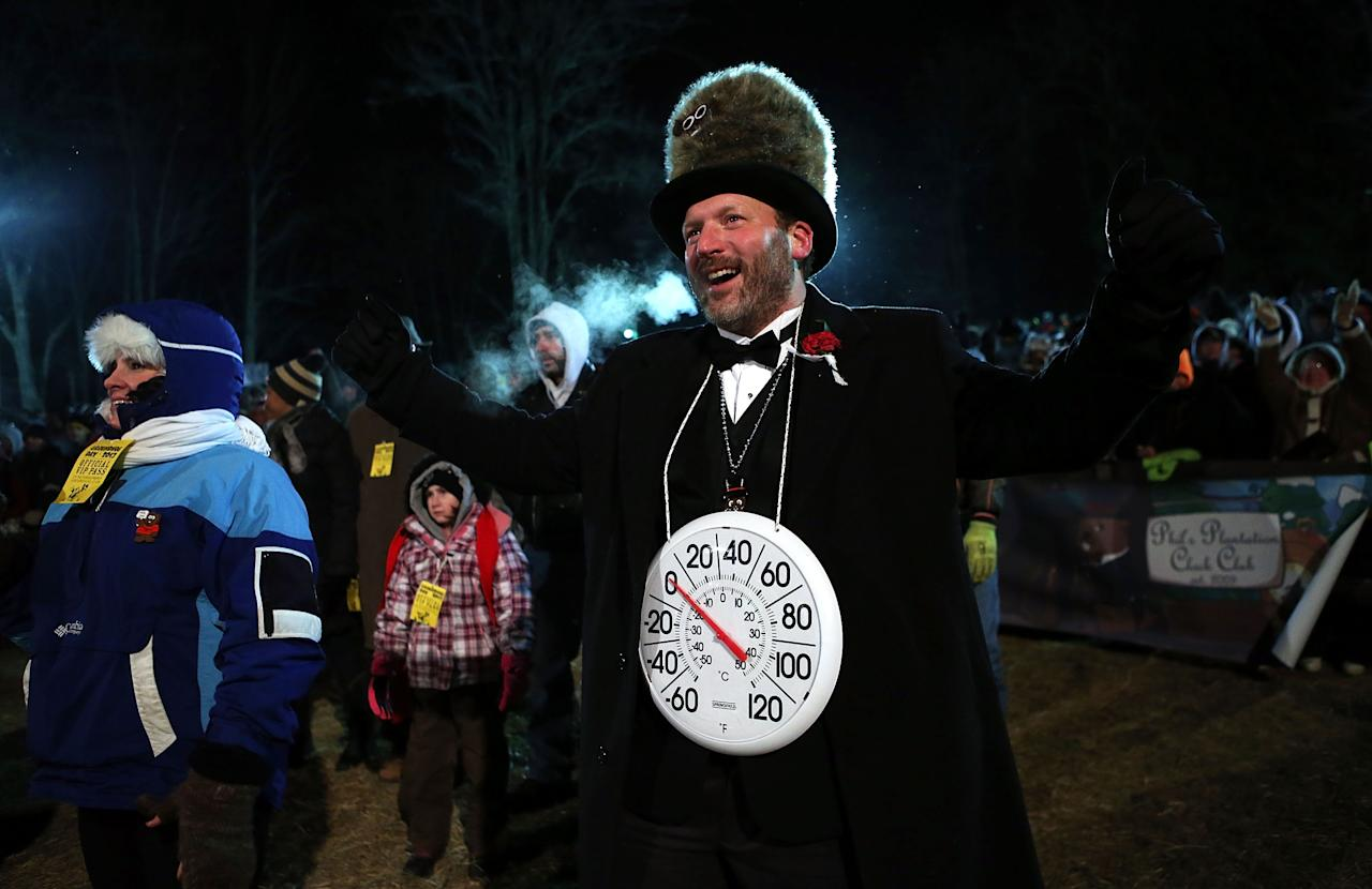 PUNXSUTAWNEY, PA - FEBRUARY 02:  'Big Chill' Jason Grusky, a member of the Punxsutawney 'Inner Circle,' gestures during the 127th Groundhog Day Celebration at Gobbler's Knob on February 2, 2013 in Punxsutawney, Pennsylvania. Thousands of people gathered at the event to watch Punxsutawney Phil's annual forecast.  (Photo by Alex Wong/Getty Images)