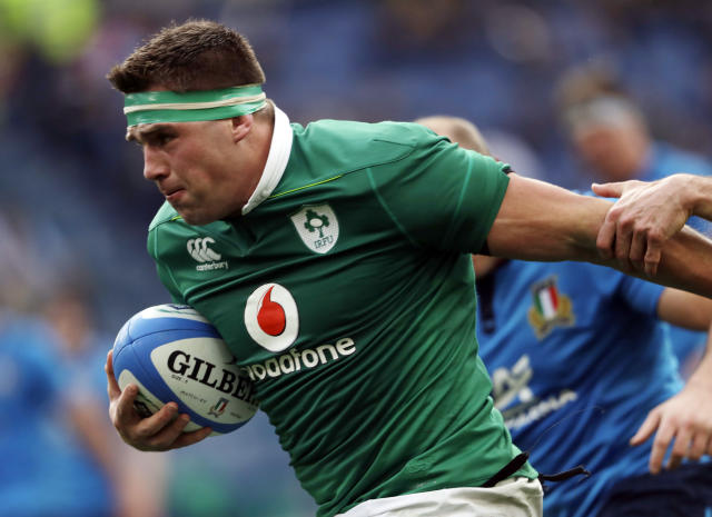 FILE - In this Saturday, Feb. 11, 2017 file photo, Ireland's CJ Stander runs on his way to score during a Six Nations rugby union international match between Italy and Ireland at the Rome Olympic stadium. Ireland will be under some pressure to confirm its the best in Pool A of the Rugby World Cup starting Friday Sept. 20, 2019. CJ Stander has 34 caps and counting, and is a regular for Ireland for his unrelenting workrate. (AP Photo/Alessandra Tarantino, File)