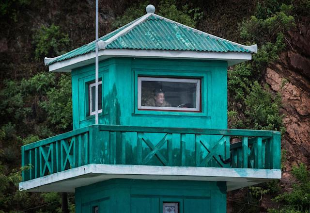 <p>A North Korean soldiers watches from a tower on the Yalu river north of the border city of Dandong, Liaoning province, northern China near Sinuiju, North Korea on May 23, 2017 in Dandong, China. (Photo: Kevin Frayer/Getty Images) </p>