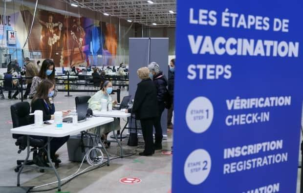 A new vaccination site opened in Bill-Durnan Arena in NDG on Wednesday.  (Paul Chiasson/The Canadian Press - image credit)